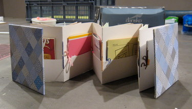 Completed recycled accordion book