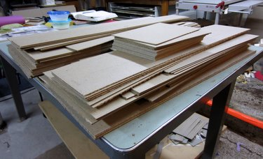 Piles of cut bookboard