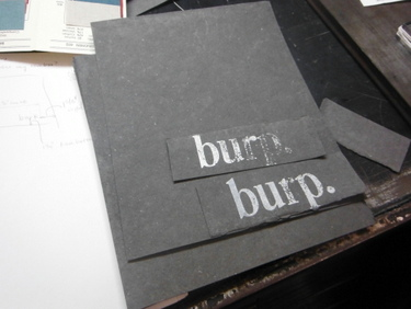 Handmade paper with letterpress print in white and silver