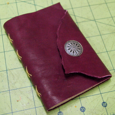 Magenta handmade leather journal with button closure