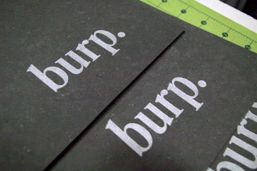 "Handmade paper letterpress printed with the word ""burp"""