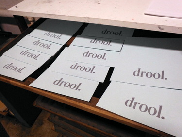 "Paper printed with the word ""drool"""