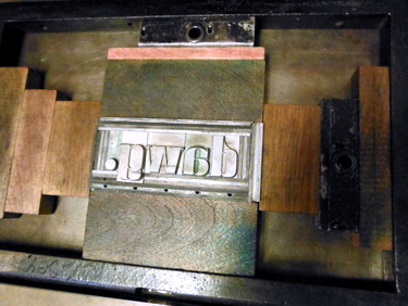 Letterpress type locked in chase