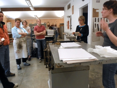 Sarah Bryant teaching pressure printing at the Paper and Book Intensive