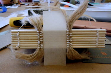 Medieval bookbinding spine in progress