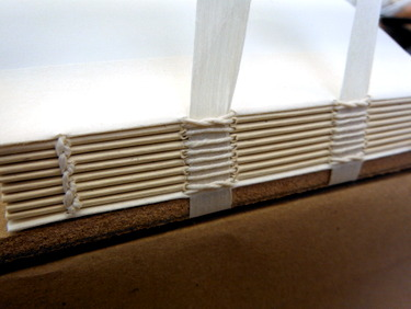 Spine sewing of simplified binding