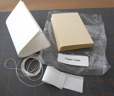 Materials kit for non-adhesive paper case binding