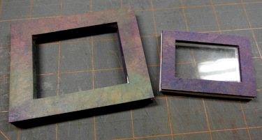 Mat board window frame covered in colored paper