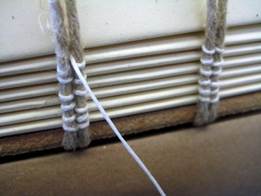 Medieval binding - sewing on double cords