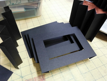Folded and cut paper for tunnel book