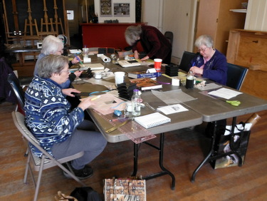 Bookbinding workshop students hard at work