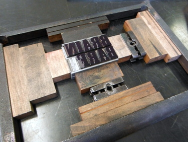 Wood letterpress type locked in chase