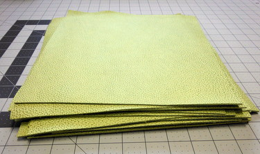 Pile of green leather squares