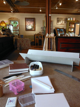 Bookbinding setup at Miller's Thumb Gallery