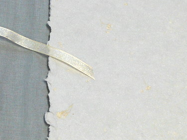 Handmade paper, bookcloth, and ribbon