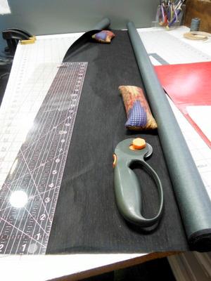 Cutting bookcloth in progress