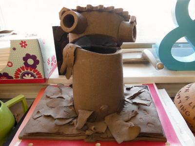 Ceramic bookworm-bot