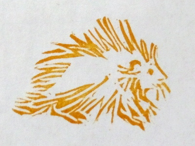 Hand-carved rubber stamped image of porcupine