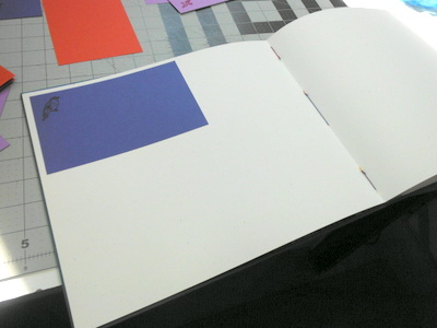 Photo album page with hand-stamped paper mat