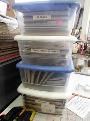 Plastic tubs full of handmade journals