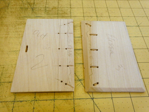 Drilled holes and carved channels in wood cover boards