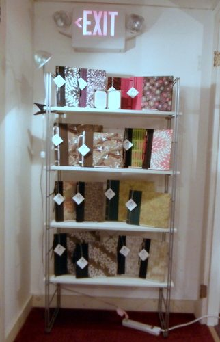 Bookshelf with handmade books by Elissa Campbell of Blue Roof Designs