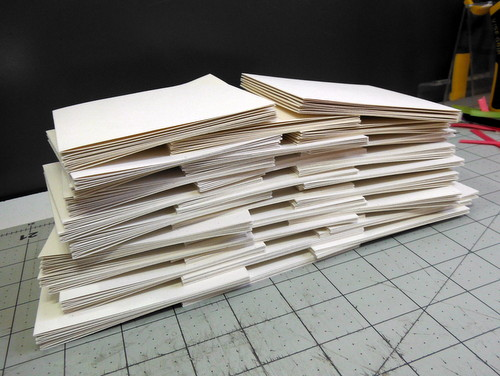 Folded cover weight paper strips