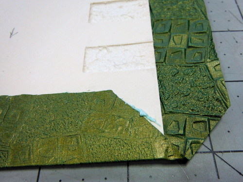 Covering boards with paper and folding corners