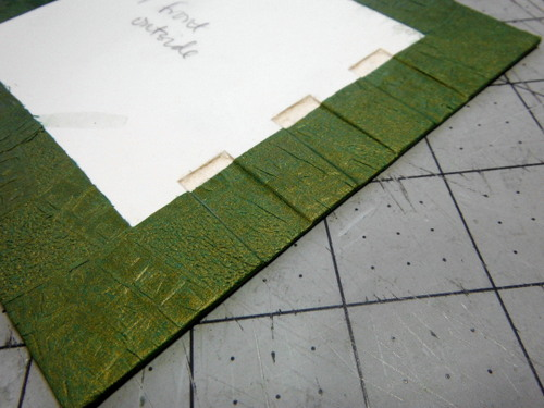 Paper wrapped cover boards with carved channels