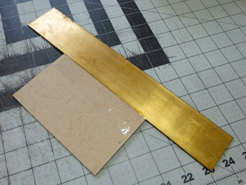 Bookboard and brass rule guide for trimming pages