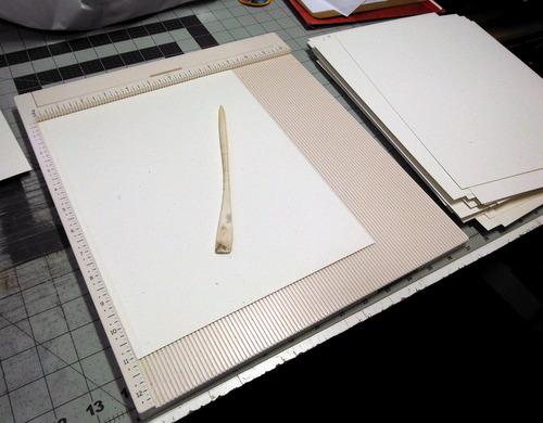 Scoring board, paper and bone folder