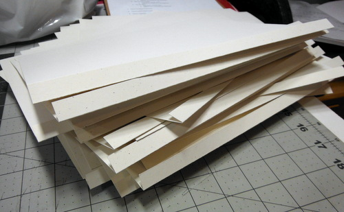 Messy pile of folded paper