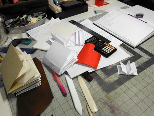 Messy studio worktable