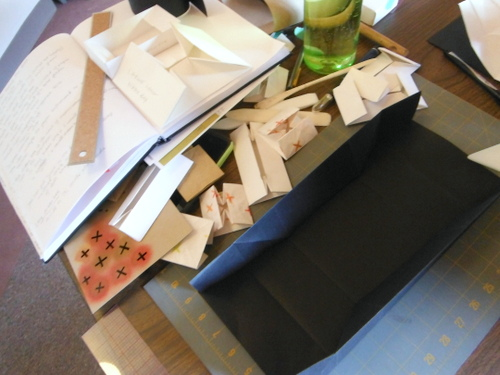 Messy worktable with Masu boxes