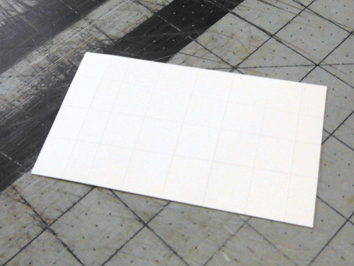 White Tyvek with double-sided adhesive sheet mounted on the back