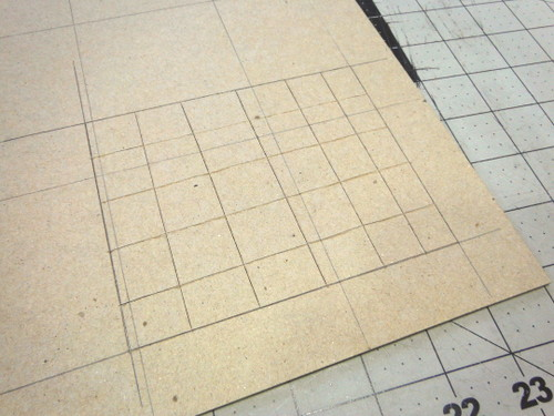 Bookboard with gridlines cut with an X-Acto knife