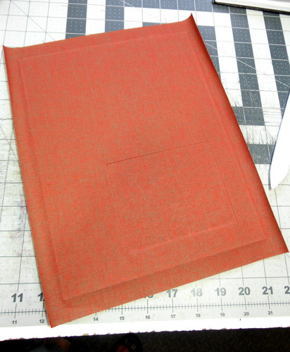 Covering bookboard with red bookcloth