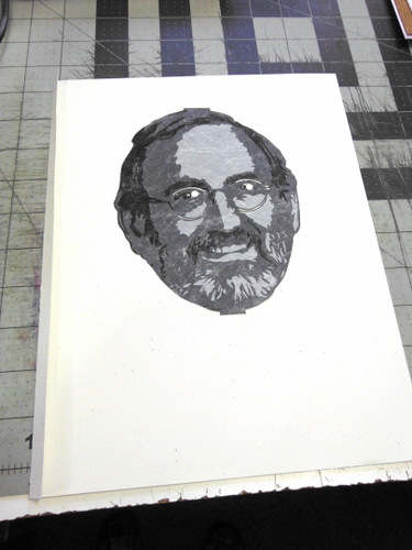 Cut Tyvek portrait adhered to a piece of paper
