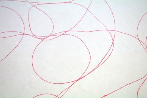White paper with embedded red threads