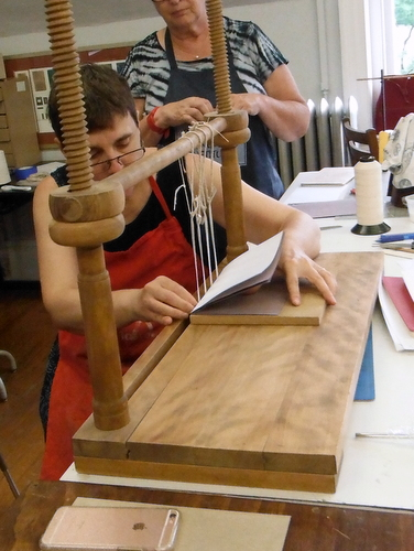 Karen Hanmer doing a text block sewing demonstration