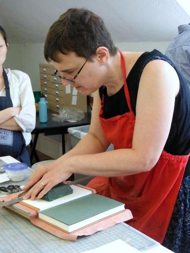 Karen Hanmer doing a bookbinding demonstration