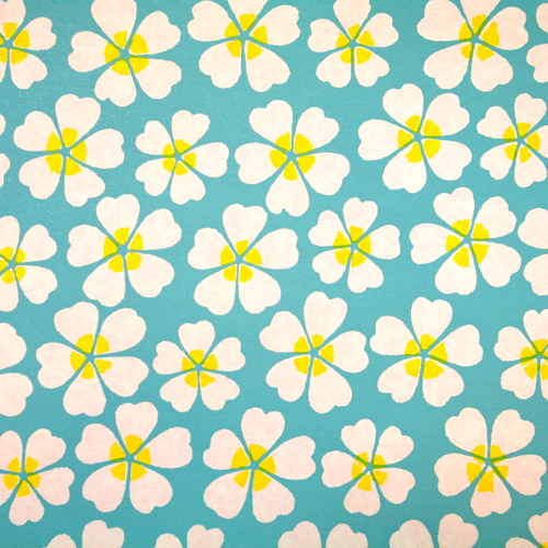 Blue letterpressed paper with white and yellow flowers