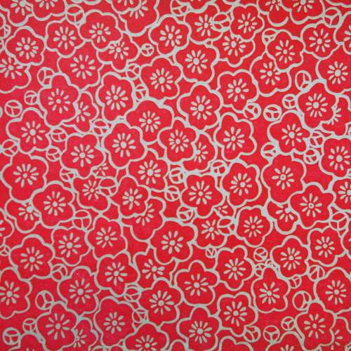 Red letterpressed paper with silver flowers