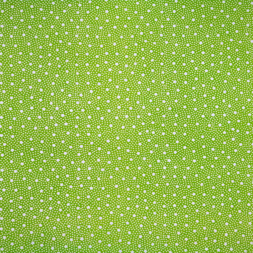 Green letterpressed paper with white flowers and polka dots