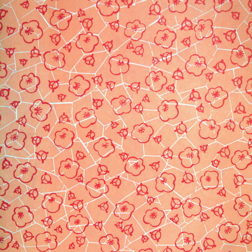 Peach letterpressed paper with red flowers