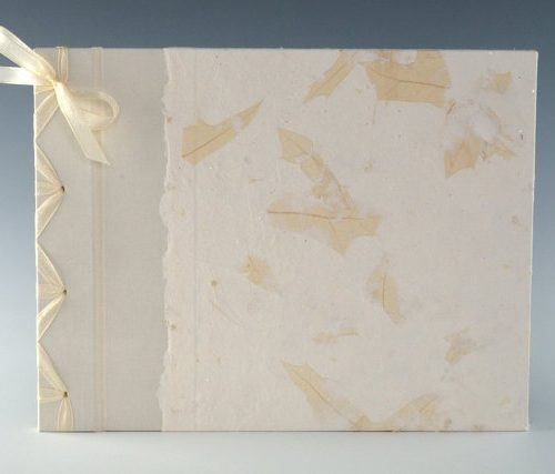 Handmade guest book with leaves by Elissa Campbell of Blue Roof Designs