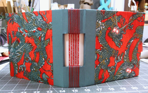 Journal with buttonhole binding and LED lights