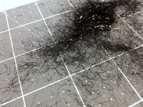 Pieces of hair from cut pieces of leather